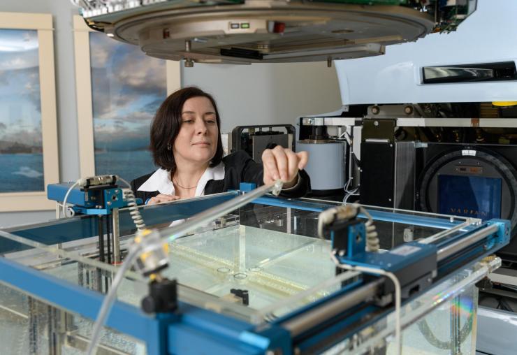 Anna Erickson with prototype radiation detector