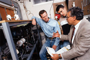 Professor Said Abdel-Khalik, Jonathan Kennedy (B.S., Georgia Tech) and Gregory Ranch (B.S., U.S. Naval Academy) conduct an experiment on critical heat flux and the onset of flow and instability in prototypical microchannels for the Savannah River Site project for accelerator production of tritium.