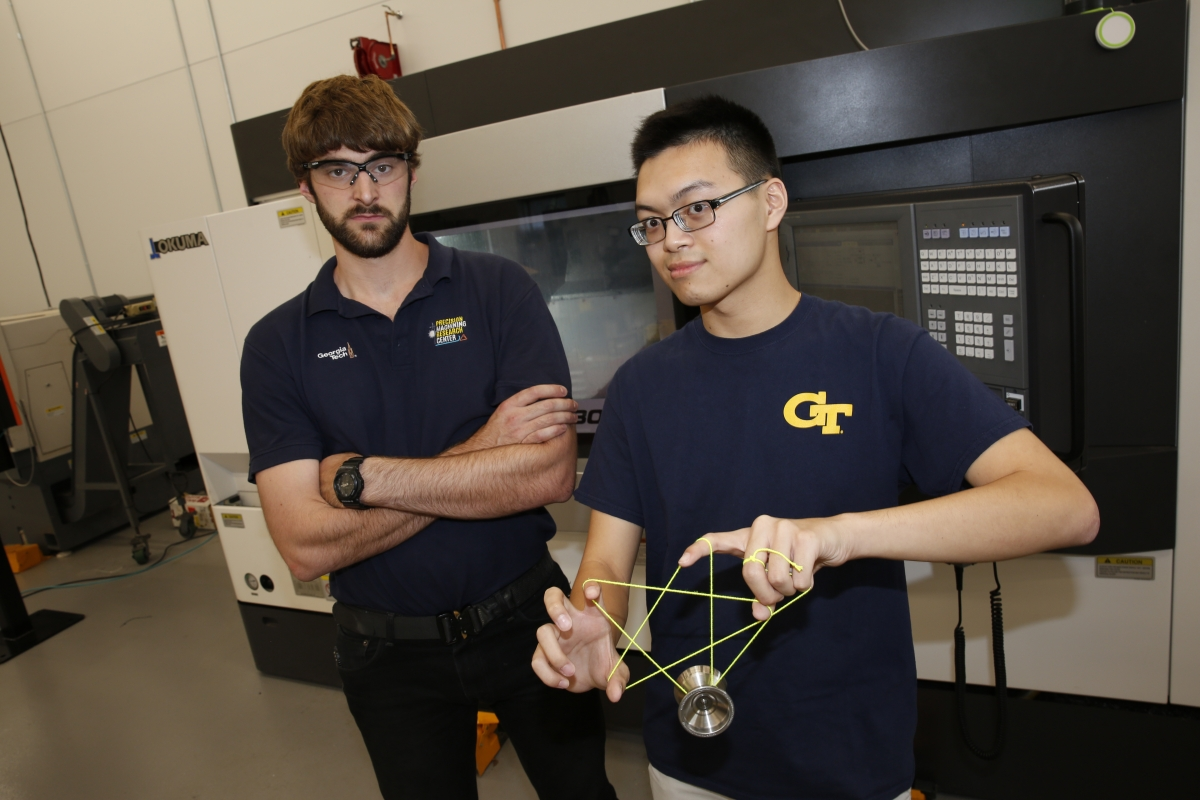 Darren Tan and Roby Lynn pose with titanium yoyo